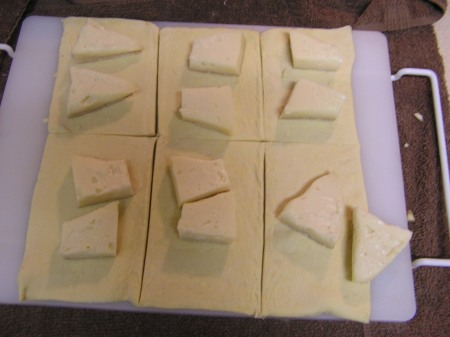 Staging the puff pastry and pieces of Brie